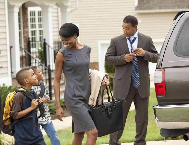 A picture of a family getting into a car
