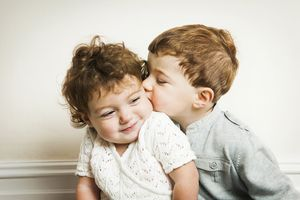 Little boy kissing little girl.