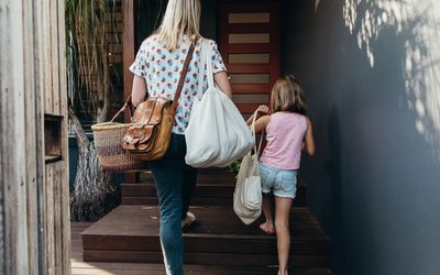 step mom and daughter walking up some stairs