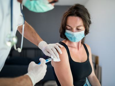 woman getting a vaccine