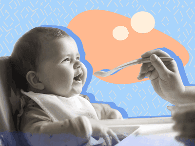 Baby getting spoon-fed