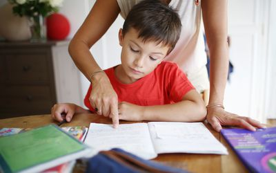 mom helping her son do his homework