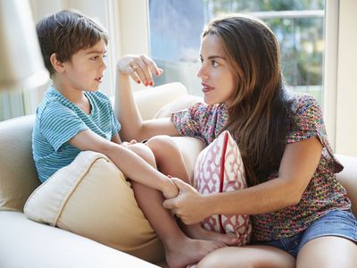 Mother talking to son on the sofa
