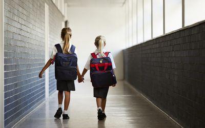 School girls walking hand in hand