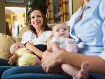 Breastfeeding moms and their babies at a lactation support group