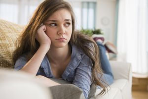Anxious girl laying on sofa