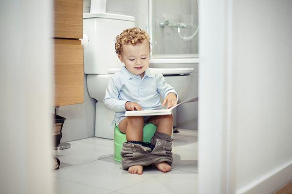 Child sitting on the toilet