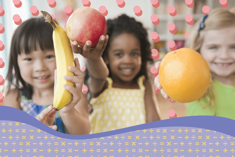 Children holding up fruit