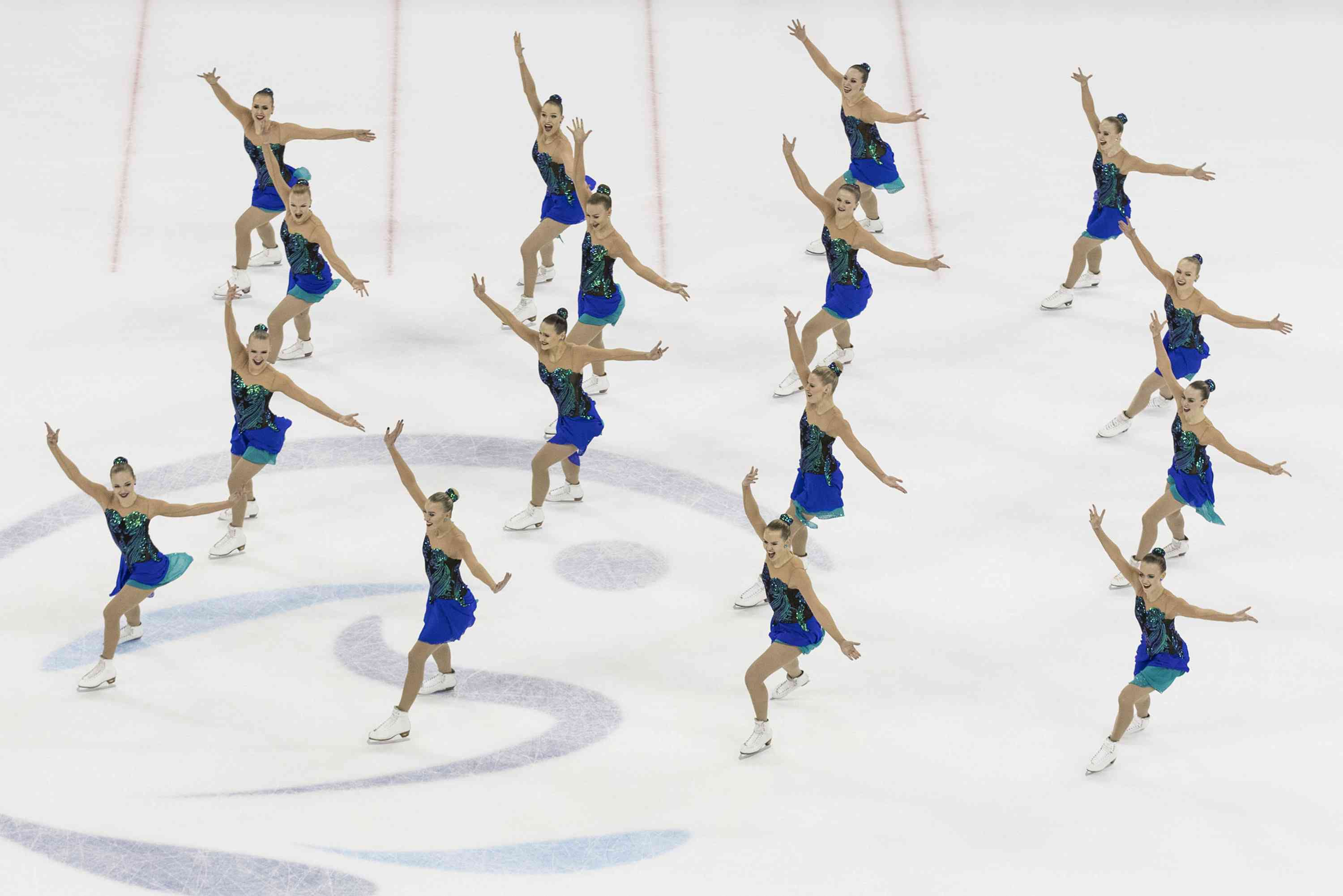 Team of synchronized skaters on the ice