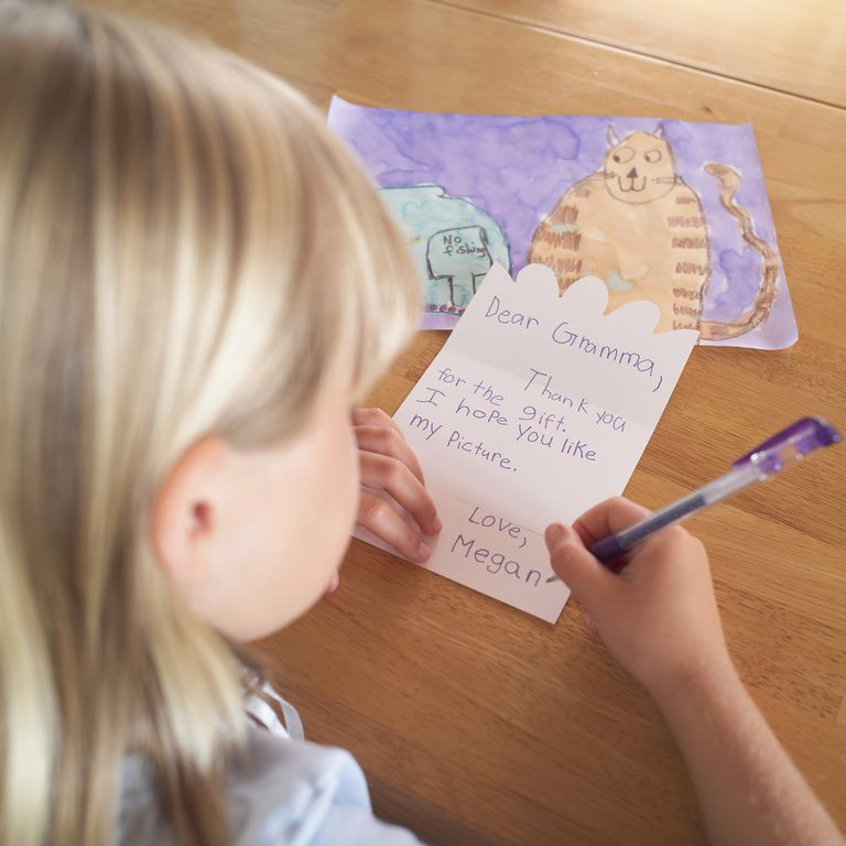 child writing thank you note