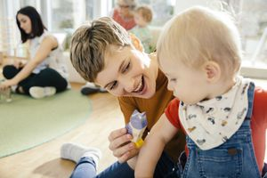 daycare provider playing with baby