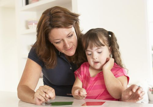 Girl with Down Syndrome having speech therapy
