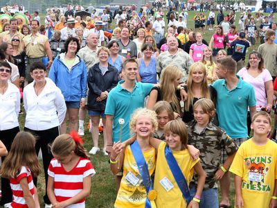 Groups of twins at an outdoor festival