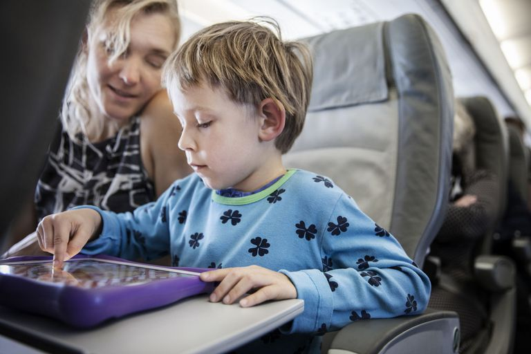 Child playing a game on an airplane