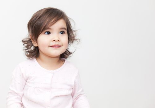 Girl smiling in long sleeve pink shirt