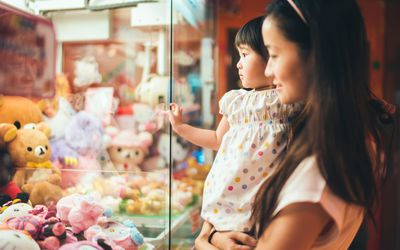 Mother and child looking at toys