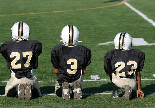 kids football - players on sidelines