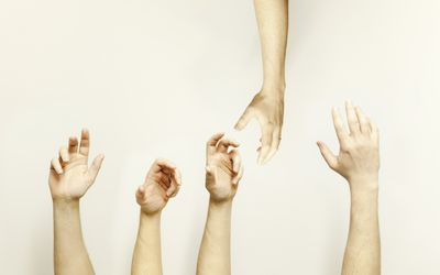 Hand reaching down to help others, metaphor for infertility