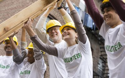 Teens volunteering with construction project