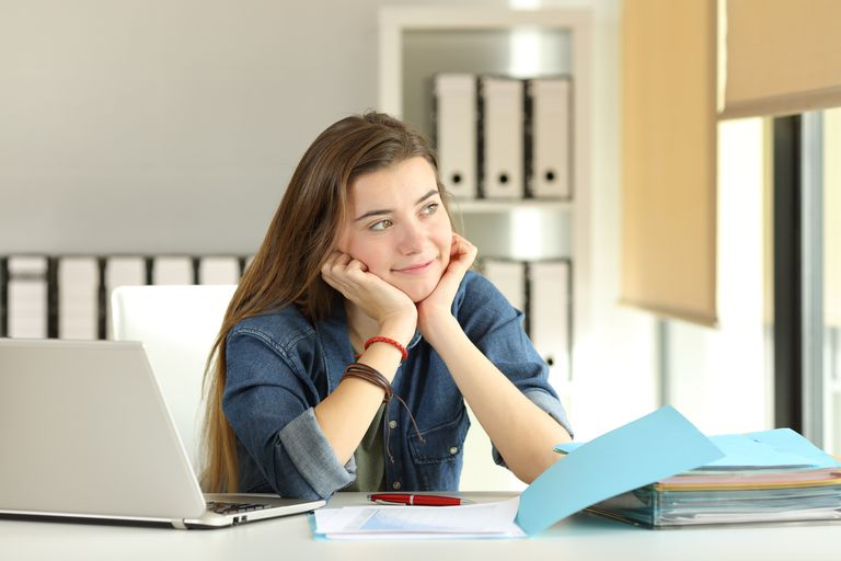 smiling teen girl with laptop