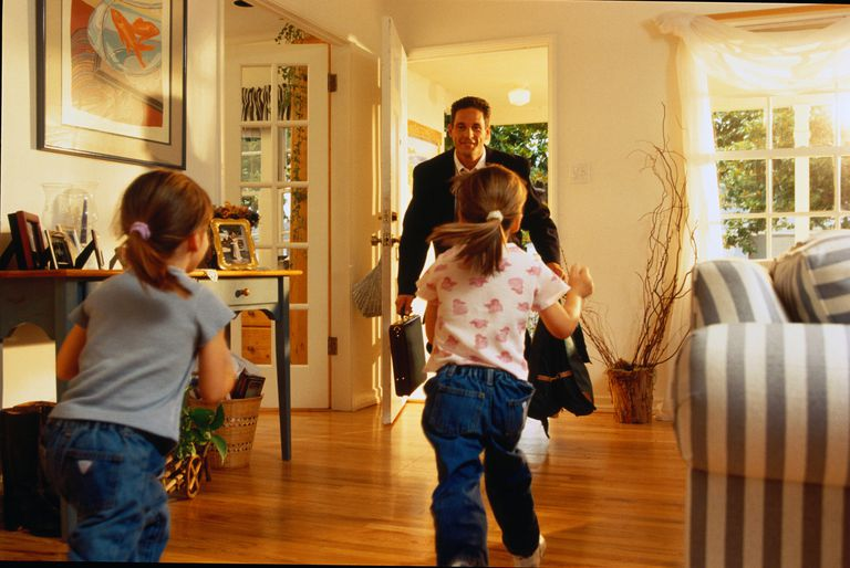 Father coming home from work, daughters(3-5)running to greet him