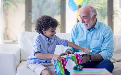 little boy opening a present