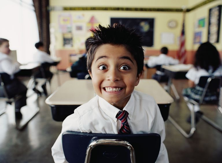 Excited boy in classroom