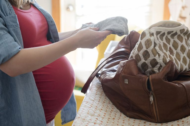 pregnant woman packing bag
