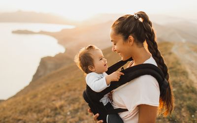 Baby in baby carrier with mother