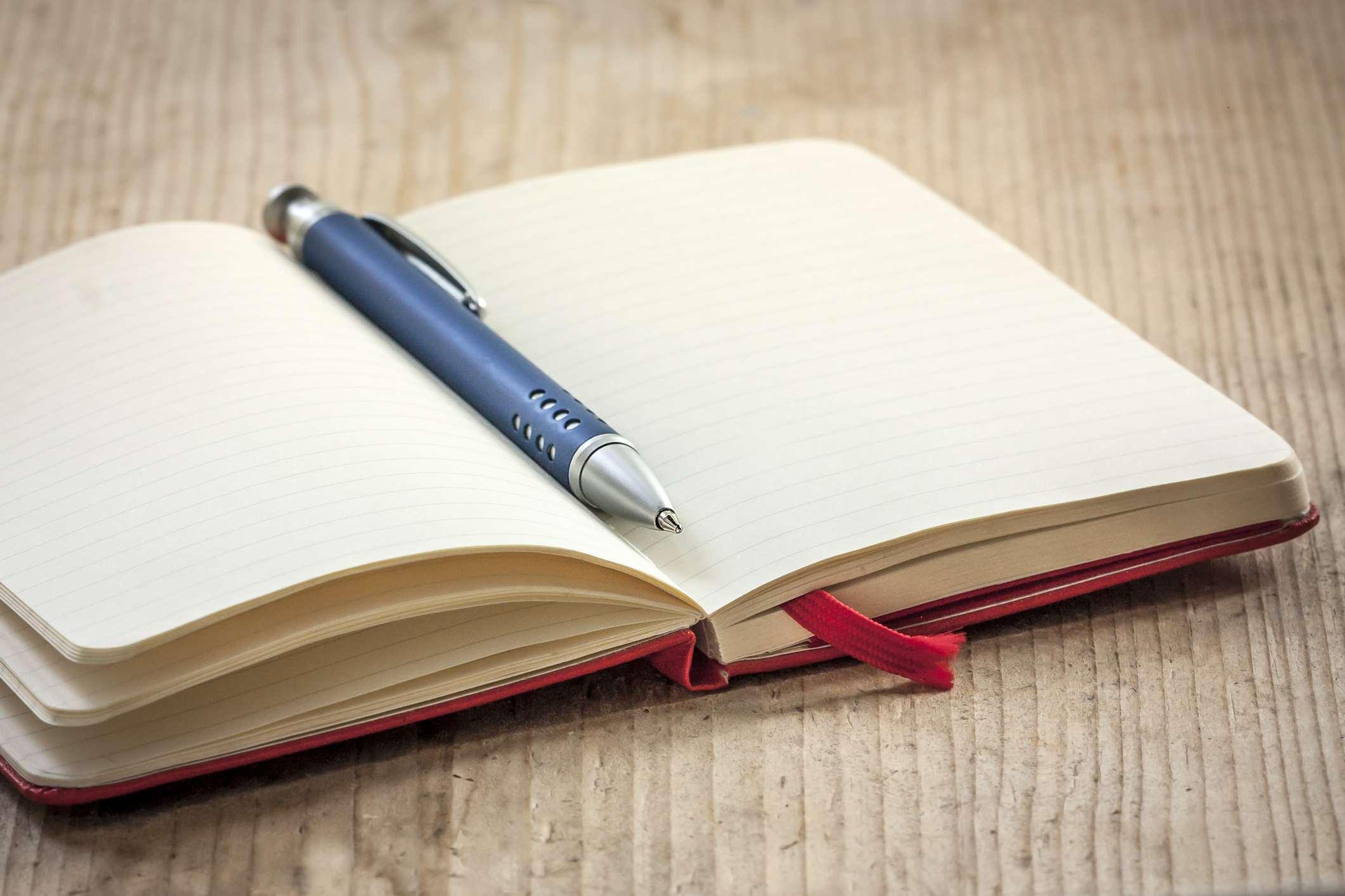 Notizblock und Stift