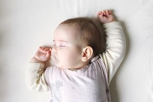 Close-Up Of Cute Baby Sleeping On Bed