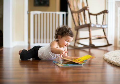 Little girl reading board book