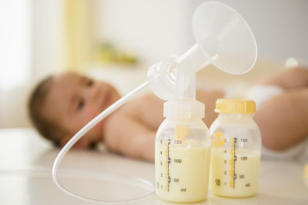 Breast pump next to baby