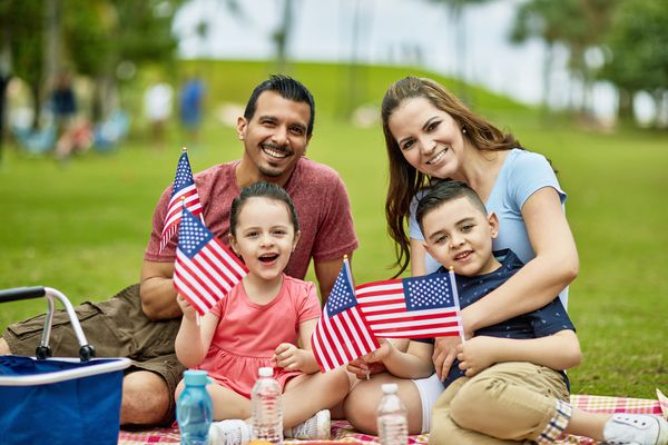 Family with flags on July 4th