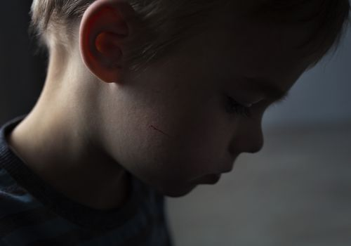profile of sad little boy