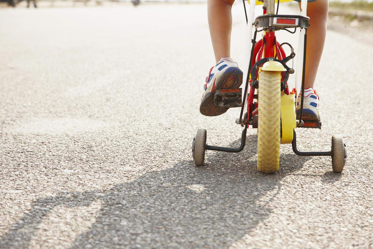 Child tricycling in the street