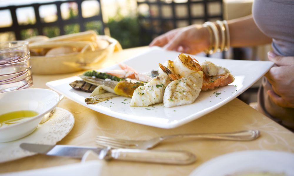 woman eating fish