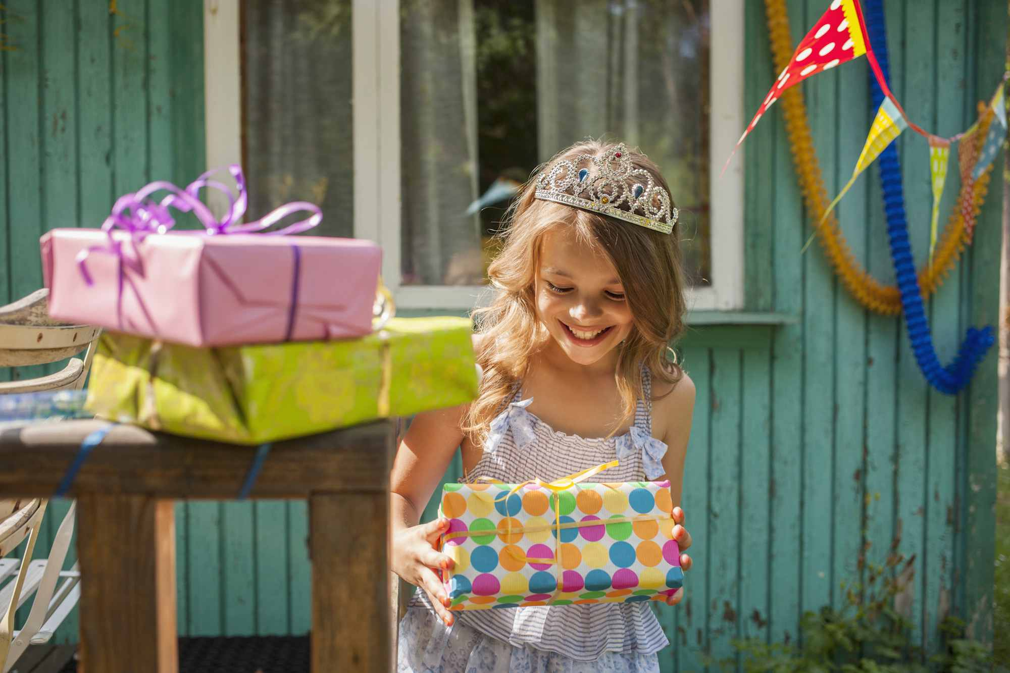 girl holding gift at birthday party