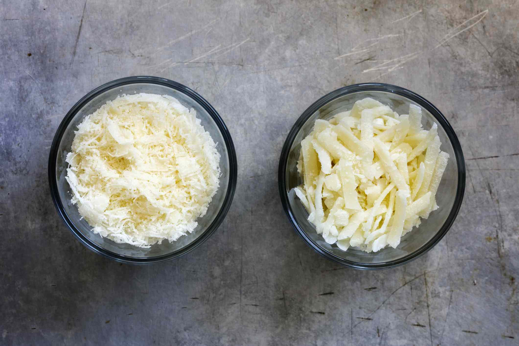 Different grated parmesan in glass bowls