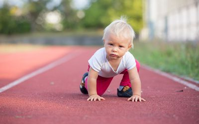 Blond baby boy on track