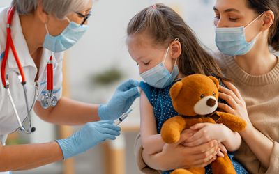 doctor vaccinating child