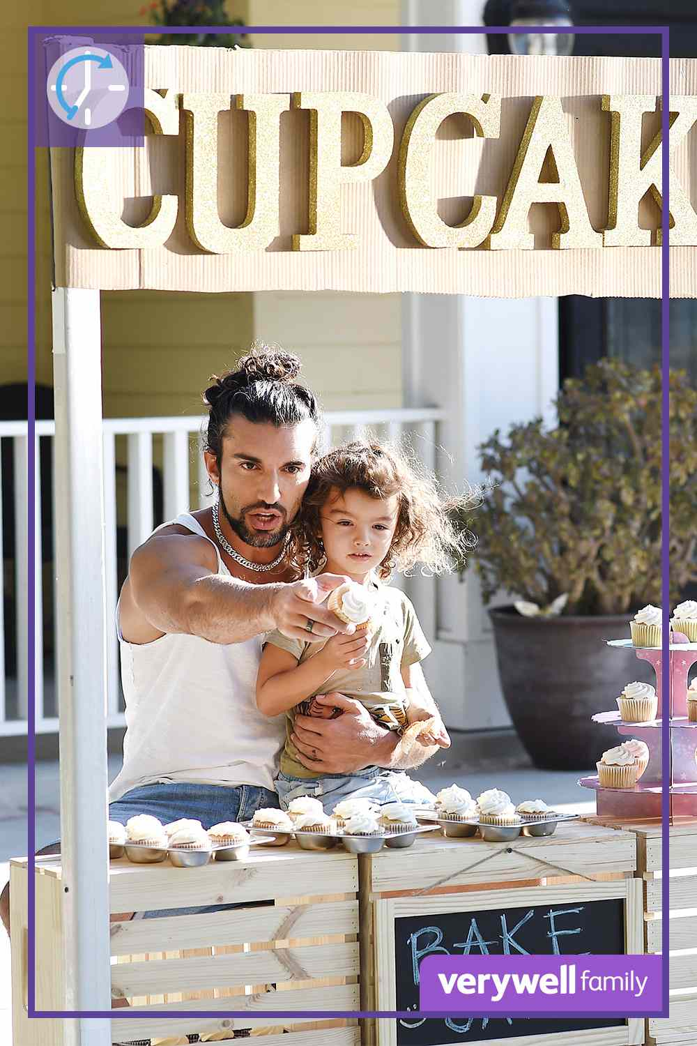 Justin Baldoni at a cupcake stand with his child