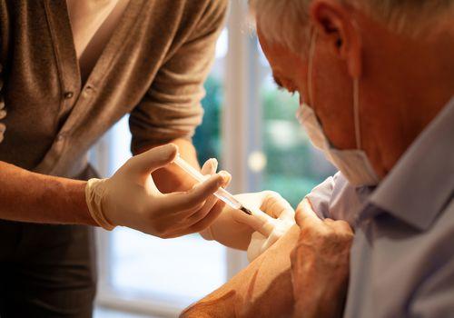 Grandfather getting Vaccine