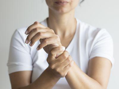 woman holding painful wrist