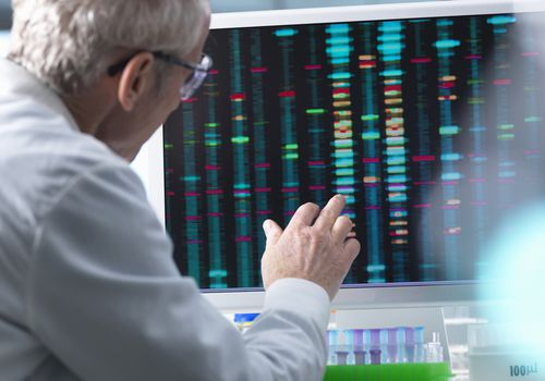 DNA Research, Scientist comparing DNA results on a computer screen in the laboratory