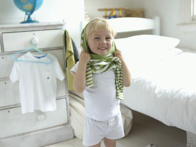 boy getting dressed