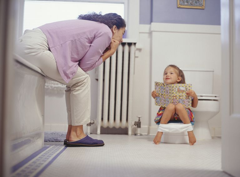Mother potty training her daughter