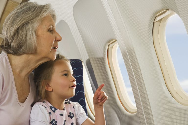 Grandmother and granddaughter on airplane