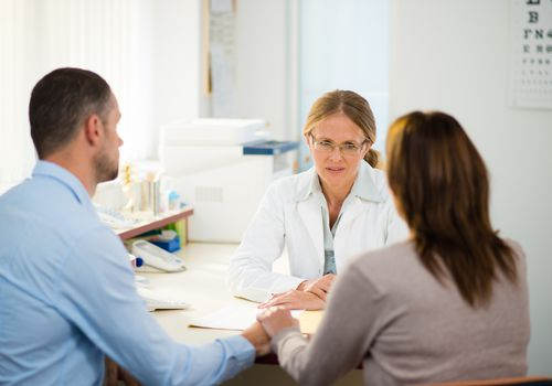 Couple in a consultation with a female doctor