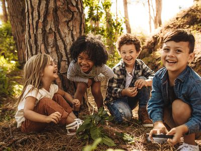 cute children playing in the forest